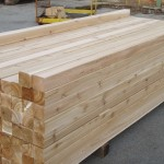 Appearance Knotty Timbers - stacked in the yard