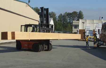 28 foot fir timber. being loaded, fork lift